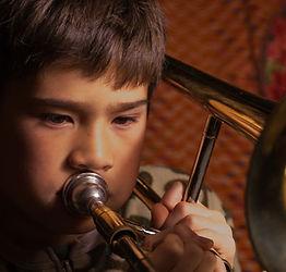 boy plays trombone