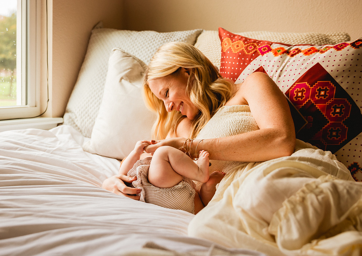 mom and baby on bed