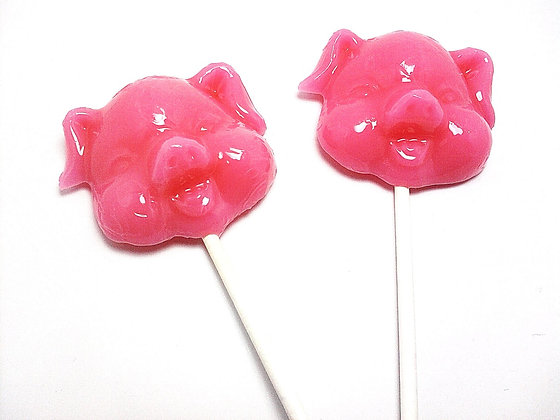 12 LARGE OPAQUE (SOLID) PIG LOLLIPOPS