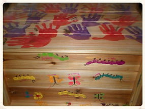Hand painted bench made by some of the students at Cambridge Park Preschool for our 2nd Annual Art Auction in 2012