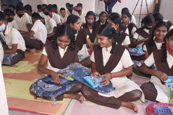 Students receiving materials in the distribution.