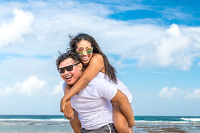 Canva - Asian Couple Having Fun on the B