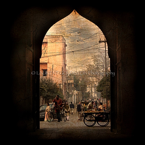 This image was taken under the porch of an old palace in Varanasi (Benaras) which has been divided in several small apartments, deeper inside there is a garden with palm and mango trees and the rest of the building is left to some administration. From the street it is not possible to know that such a beautiful place is there. After the entrance time has stopped.