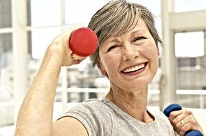 Senior exercising at gym.jpg