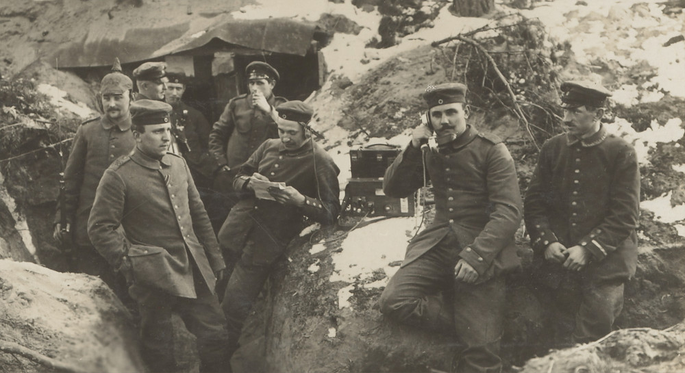 This is an image of soldiers in world war 1 using the then relevant technology of telephony.