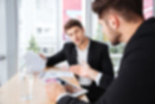 graphicstock-two-young-businessmen-discu