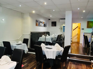 Nazreen front first level dining area with covid safety measures on the floor for social distancing.jpg