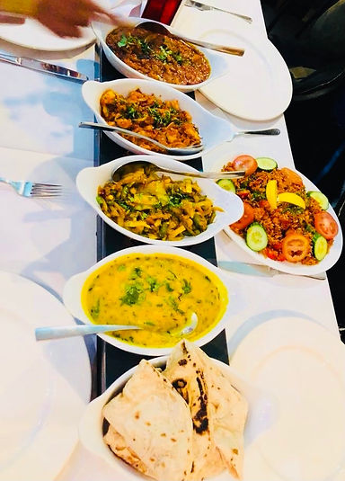 indian food with rice on plates top view of table.jpg