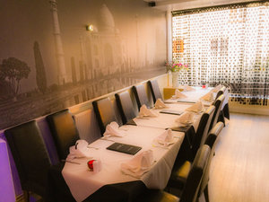 Nazreen first level dining area for larger groups with Taj Mahal mural in background.jpg