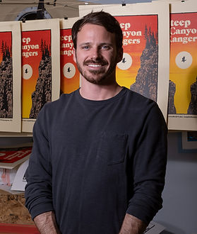 Tom Shaw with posters for Steep Canyon Rangers