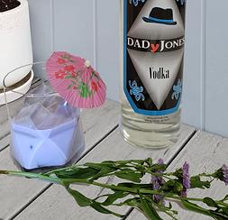 cocktail called purple rein with bottle of DADyJones vodka bottle