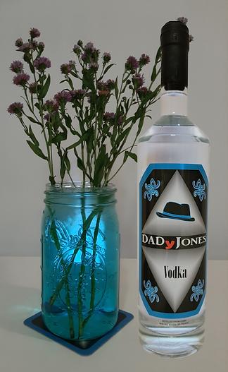 DADyJones vodka bottle and flower vase with translucent blue water
