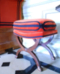 Mobilier de Style | Charlotte et Claire | Tapissier d'ameublement Nimes | Tabouret ployant style Directoire | Garniture à l'ancienne en crin végétal | Coussin en plumes | Finition galons et cartisanes cousues main| Tissusoie et coton | Sur commande d'Olivier Berni Intérieur
