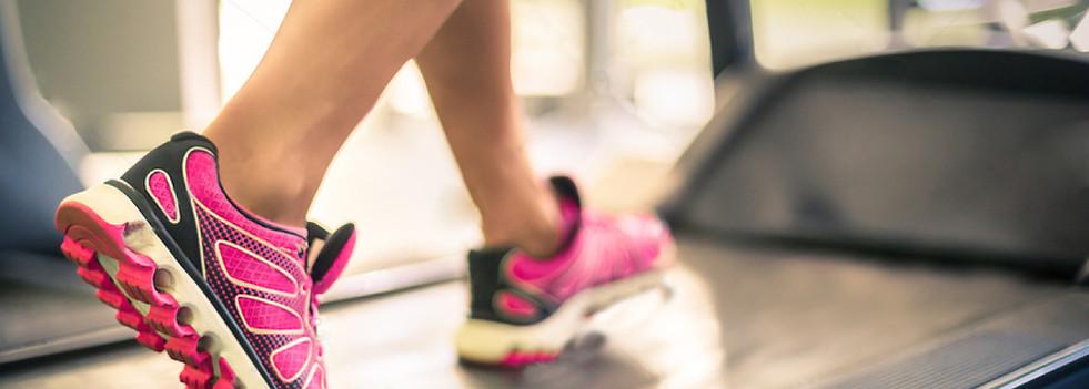 stock-photo-fitness-girl-running-on-trea