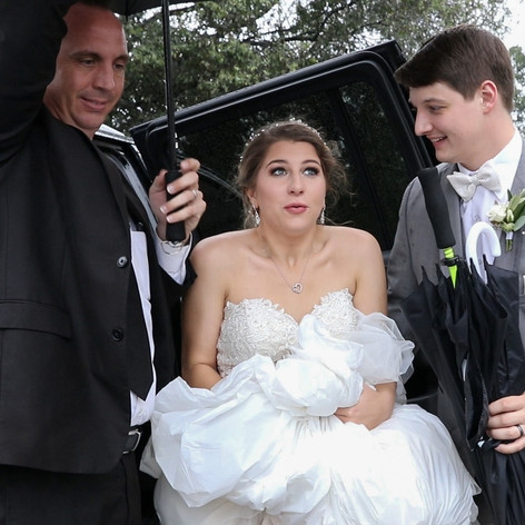 Rachel & Dylan getting to reception during hurricane Florence