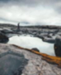 person walking on rocks
