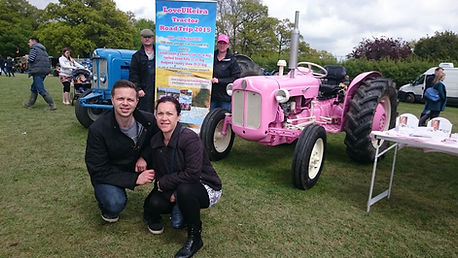 Keira's Mummy and Daddy with the LovUKeira tractors and team