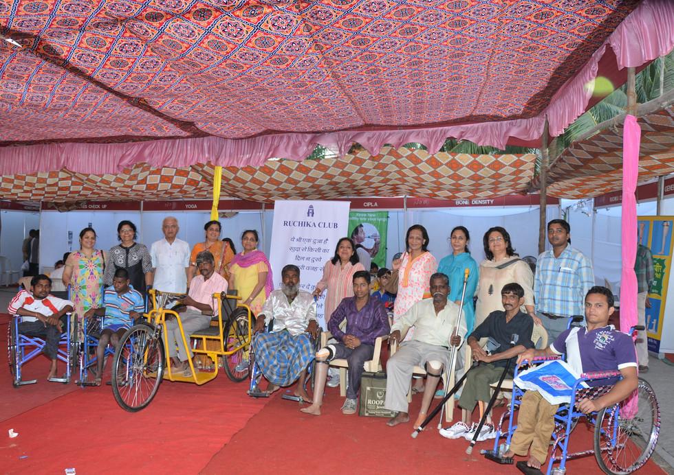 Wheelchair Receipients with Ruchika members.JPG