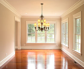 cozy unfurnished dining room with lots of windows
