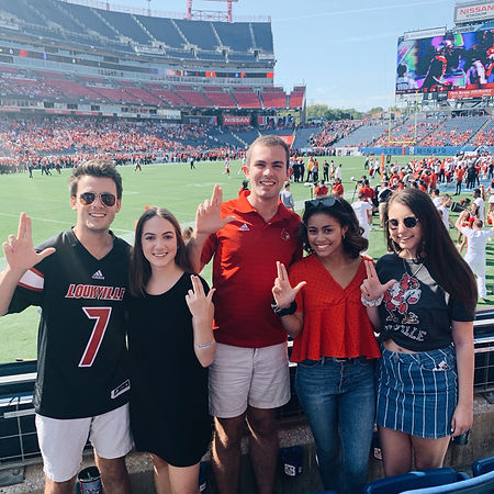 Members of SGA Executive Branch at a UofL football game