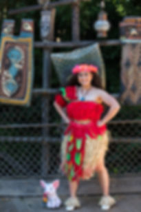 Moana in her Voyager Outfit in front of Tiki Display