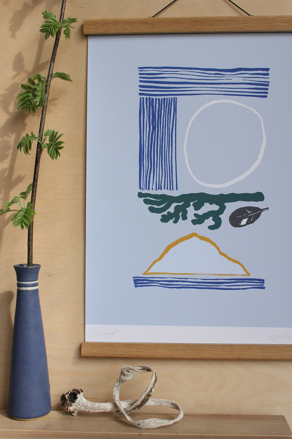 A pale blue A3 print of an original ink drawing depicting symbols relating to the Outer Hebrides such as the sea, sun, a hill, feather & seaweed