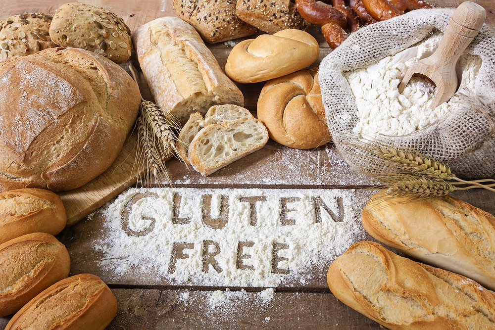 gluten free words written in flour surrounded by gluten free bread