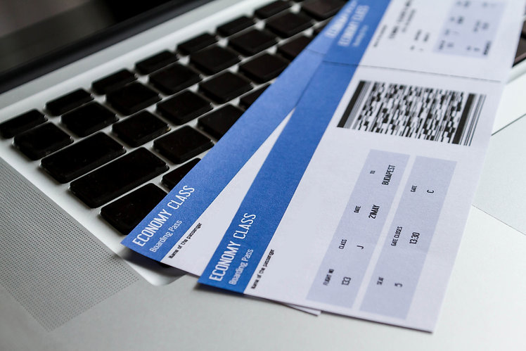Airline tickets over the keyboard of a l