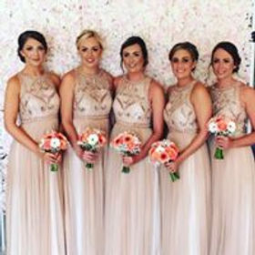 Flower wall and bridesmaids.jpg
