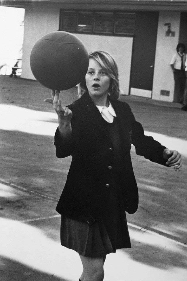 14 year old Jodie Foster showing off her basketball skills in her school uniform at Lycée Français de Los Angeles