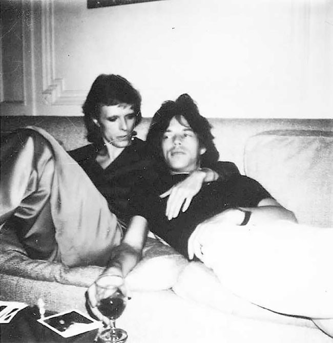 David Bowie and Mick Jagger chilling on a couch