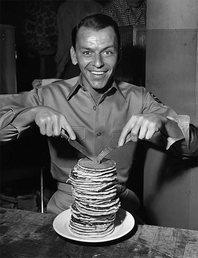 Frank Sinatra eating pancakes on the set of From Here to Eternity
