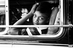 boy looking out of bus (1 of 1)