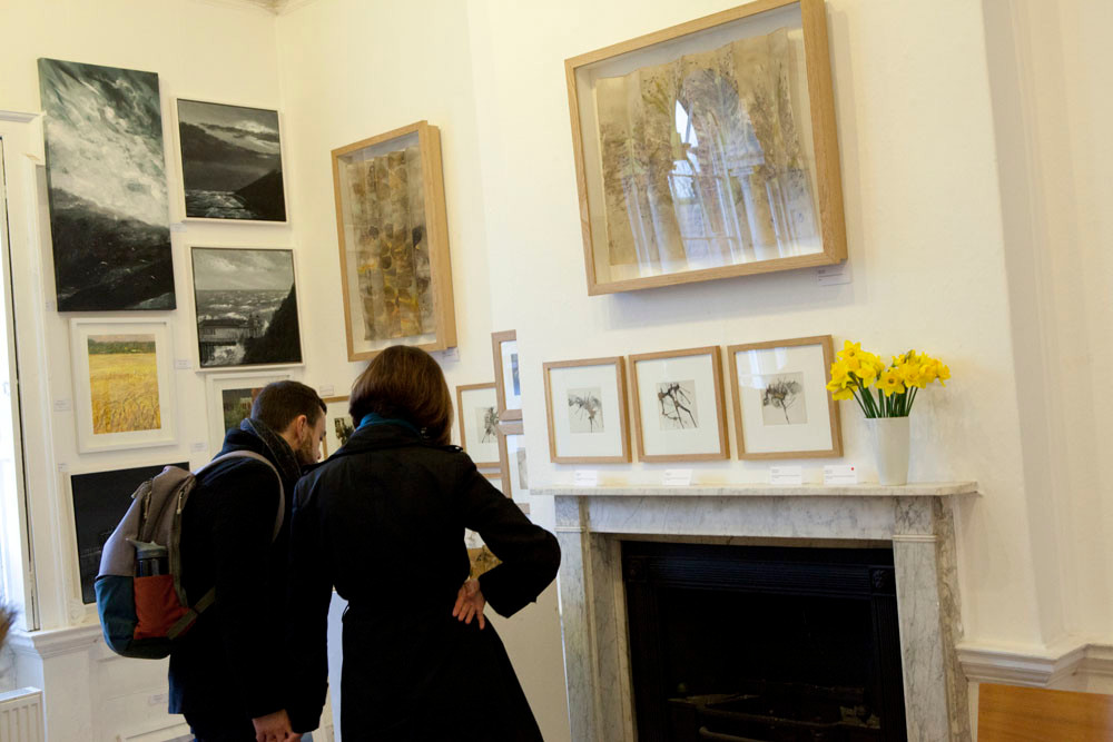 The Secret Art Fair 2019, visitors admire the work of Nicola Coe in the ballroom on the 1st Floor of The Minories Galleries in Colchster