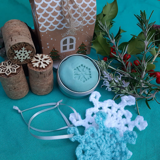 Snowflake playdough set and decorations with gingerbread hous