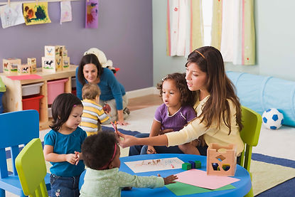 speech therapists with group of kids