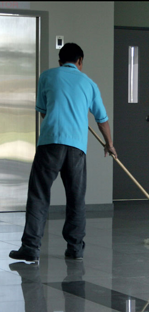 Clean-Rite employee making your hard floor sparkel