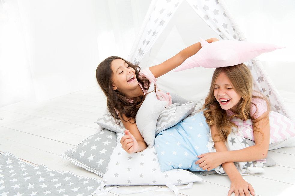 Pajamas party for kids. Girls having fun