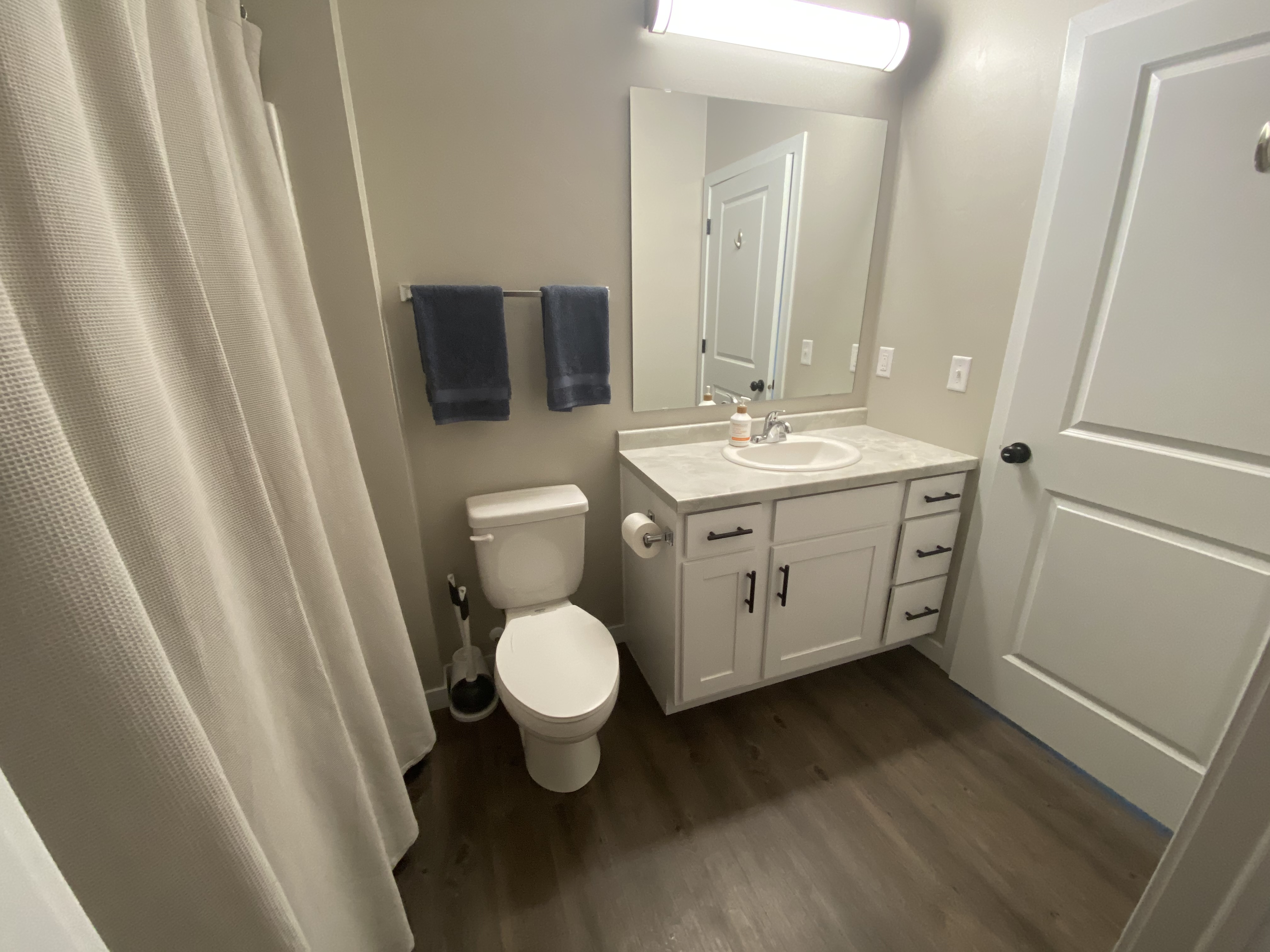 Bathroom with Shower Curtain and Towels