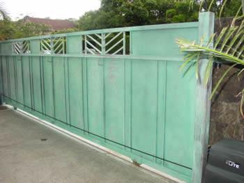 Automated galvanized driveway gate with patina finish