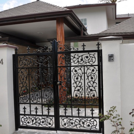 Galvanized entry gate with cast designs