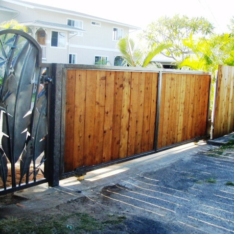 Automated stainless steel gates with a patina finish and redwood infill.