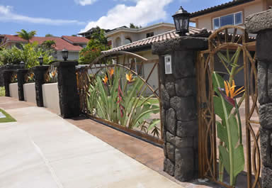 Automated aluminum driveway gate and fencing with artwork