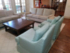 carrie 2 sofas and green chairs coffee t