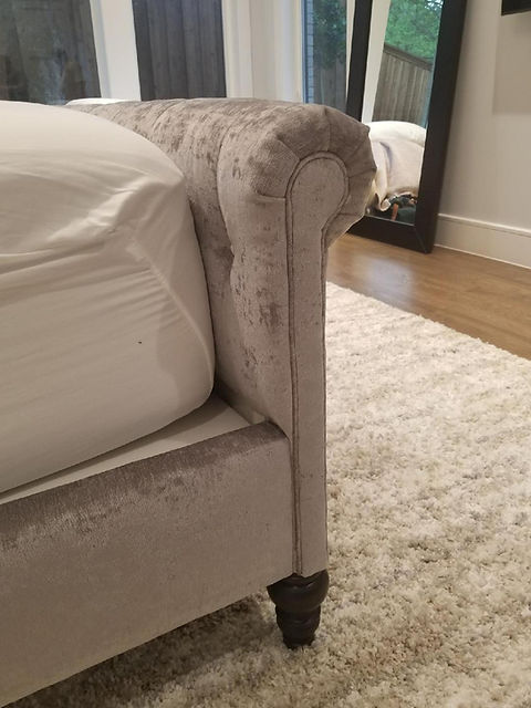 Tufted shimmery bed side roll.jpg