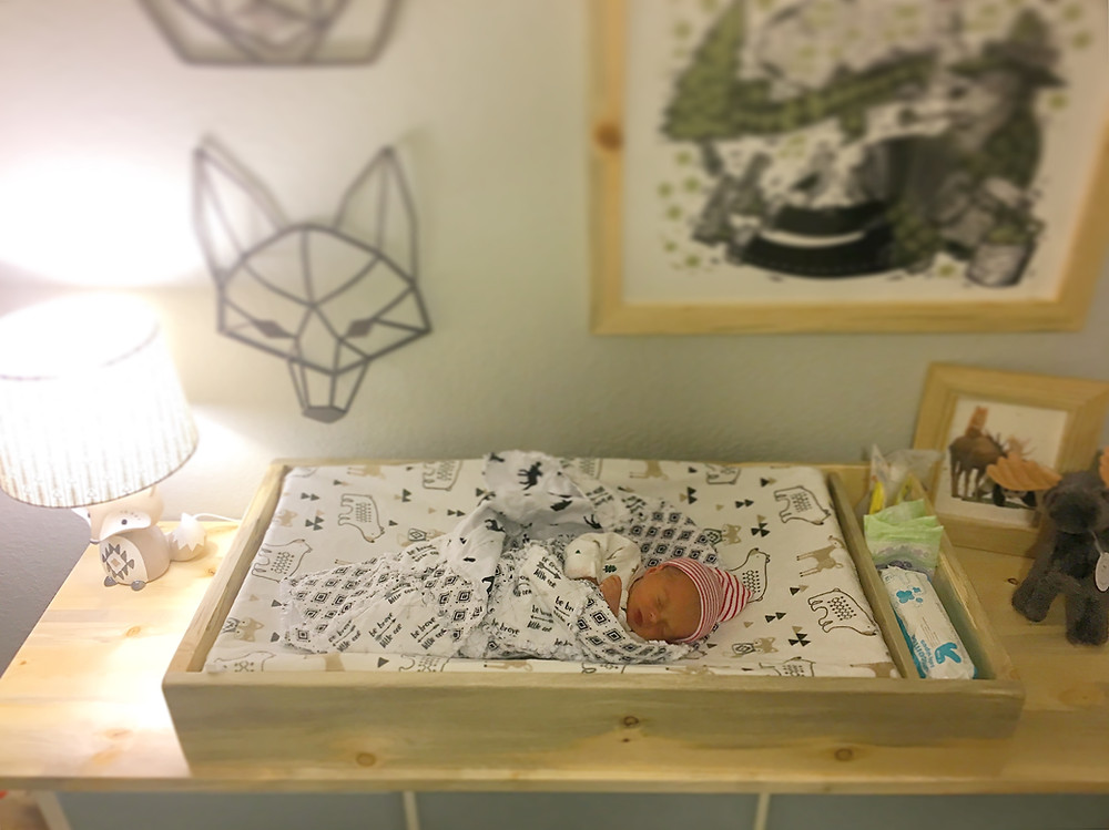 River Lee in her Custom ONE84 changing table and custom table top. Made to match the custom ONE84 picture frames.