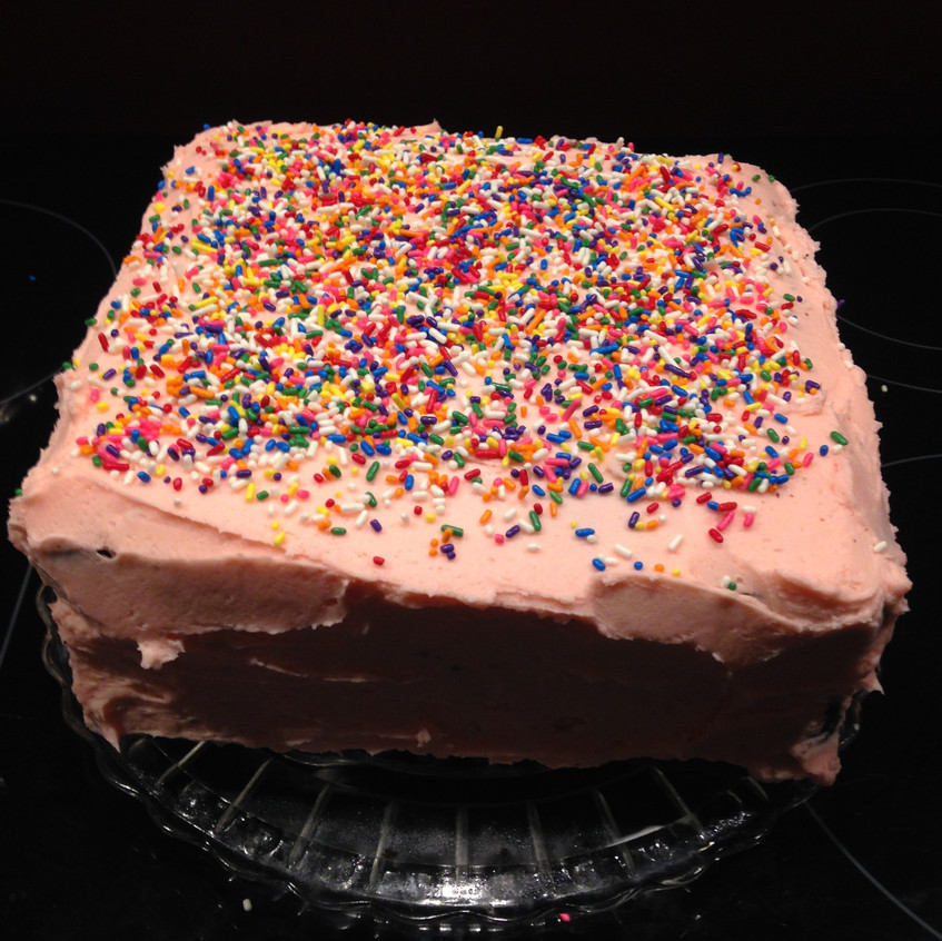 Pink almond cake with sprinkles
