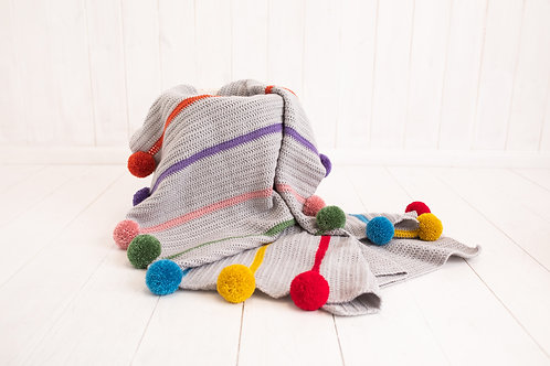 Multi coloured pompom blanket