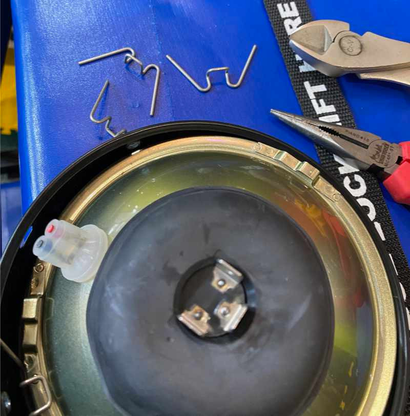 Remove the inner headlight assembly from the outer ring