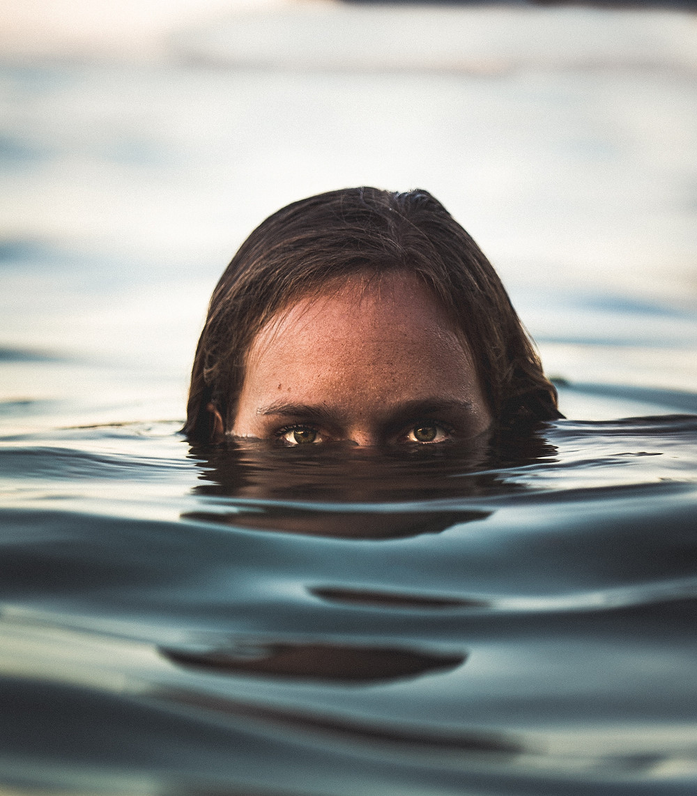 man with only half of his face above water. Symbolic of shutting out the outward senses.